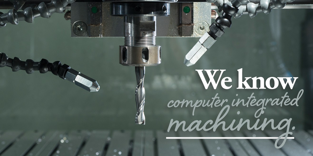 "Caption: ""We know computer integrated machining."" image of machining equipment"