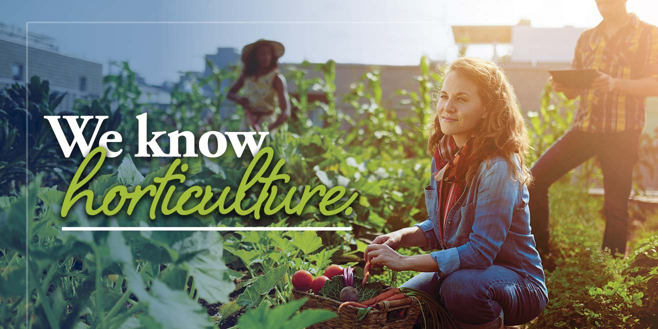 """Caption: """"We know horticulture."""" smiling student, basket and growing vegetables"""